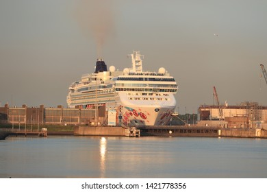 IJmuiden, the Netherlands -May 25th, 2019: Norwegian Pearl leaving IJmuiden Sea lock. Norwegian Pearl is operated by Norwegian Cruise Line