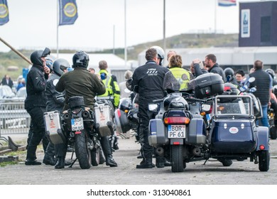 IJMUIDEN, NETHERLANDS - SEPTEMBER 04 2015: Motor bike driver waiting to get on the ferry