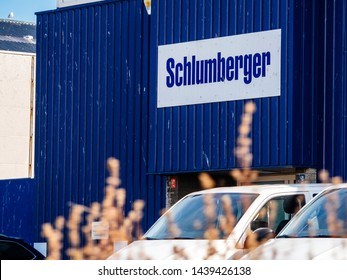 IJmuiden Santpoort Zuid, Netherlands - Aug 20, 2018: Schlumberger logotype on the facade of the local headquarter representation near petroleum port