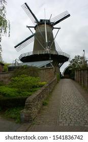 IJsselstein, The Netherlands - april 22 2017: The corn mill 'The Windotter' on the city walls of IJsselstein
