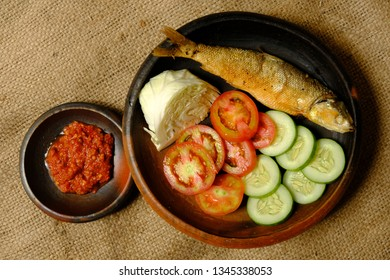 Ikan Bandeng Goreng and Sambal, fried milkfish and chili sauce. Popular street food in Indonesia. Indonesian food. Top view.