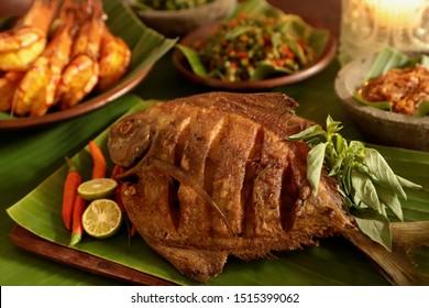 Ikan Bawal Goreng. Popular Indonesian seafood dish of fried fish.