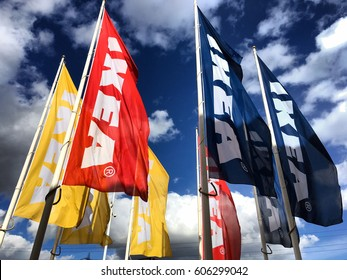 IKEA, Bluewater, London, England, March 2017; IKEA flags against sky at Bluewater IKEA Store. IKEA, founded in Sweden in 1943, is the world's largest retailer of flat-pack or self-assembly furniture.