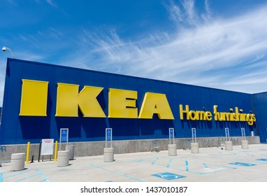 IKEA Home Furnishings sign advertises the chain store. Disabled person parking spaces near entrance - East Palo Alto, California, USA - June 27, 2019