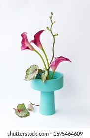 Ikebana in a turquoise vase on a white background