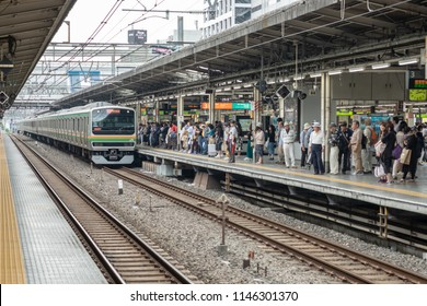 IKEBUKURO JR Train Staion, TOKYO, JAPAN - 17 June 2018 :  Crowd people waiting JR train at platform and train is arriving.