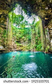 Ik-Kil Cenote, Mexico. Lovely cenote in Yucatan Peninsulla with transparent waters and hanging roots. Chichen Itza, Central America.