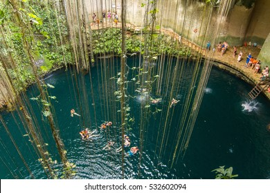 Ik-Kil Cenote near Chichen Itza, Mexico. Lovely cenote with transparent waters and hanging roots