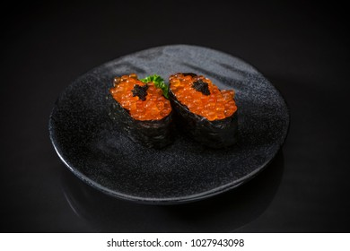 Ikura Nigiri, Salmon Eggs, Sushi bar menu, Sushi,  traditional Japanese food on ceramic dish, Japanese food style, Japanese menu, Fresh Salmon eggs sushi on black background, selective focus