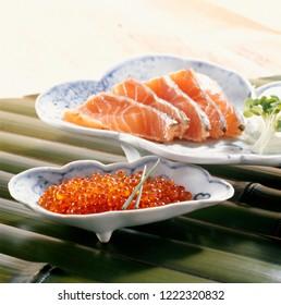 Ikura (salmon roe, red caviar, salmon caviar) and sliced salmon TATAKI