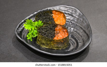 Ikura and tobiko sushi ( Salmon roe and flying fish roe sushi ) in japanese restaurant