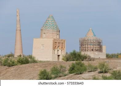 Il Aslan Mausoleum with Kutlug Timur Minaret in the background, and another mausoleum being repaired, in Konye Urgench, Turkmenistan