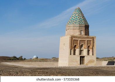 Il Aslan Mausoleum with a turquoise domed mausoleum in the background, in Konye Urgench, Turkmenistan