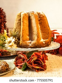 Il Pandoro, a typical Italian Christmas dessert on a beautiful table with decorations.