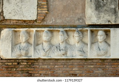 In the Ilario Fusco's tomb on the Appia Antica in Rome, there is a relief with five portraits of deads.
