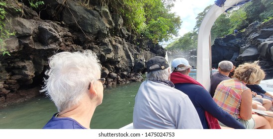 ILE AUX CERF, MAURITIUS 18,2019. A group of people on a speed boat enjoying the scenery along the banks of the mangroves in Mauritius.