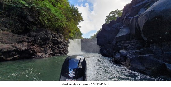 ILE AUX CERF-AUGUST 19, 2019. Waterfall and rock landscape along the banks of Ile aux cerf in the island of Mauritius.
