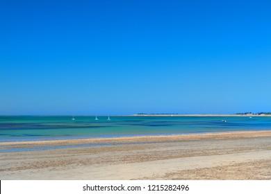Ile de Rée- Beach landscape sand and sea with sailboats at the horizon