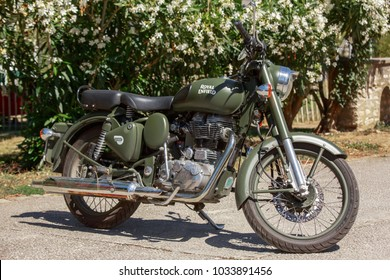 Ile de re, France - August 22, 2016 : Indian Royal Enfield 500 Classic in Military Green color parked at highway for view at Ile de re France, an island near La Rochelle.