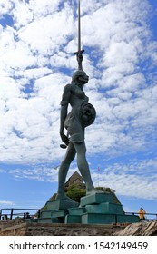 Ilfracombe, Devon, United Kingdom. 05/25/2019 Verity, the stainless steel and bronze statue created by Damien Hirst, stands on the pier at the entrance to the harbor in the town.