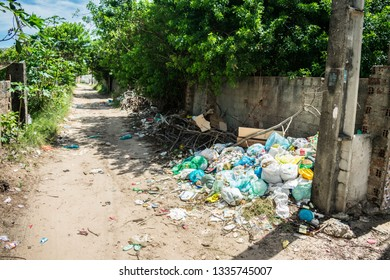 Ilha de Itamaraca, Brazil - Circa March 2019: Pile of litter at a street corner - Itamaraca has a very serious problem with rubbish disposal and trash management