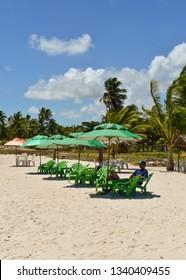 Ilha de Itamaraca, Brazil - Circa December 2018: Beach bar tables and parasols on Itamaraca Island