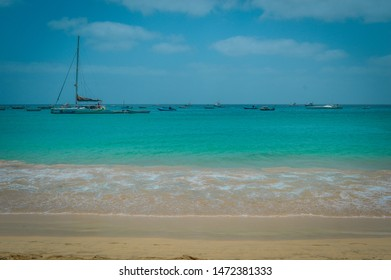 Ilha do Sal, Cabo Verde, Africa - march 22, 2017: Boats in a calm sunny day at Santa Maria Beach