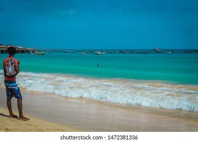 Ilha do Sal, Cabo Verde, Africa - march 22, 2017: Man enjoy a sunny day at Santa Maria Beach