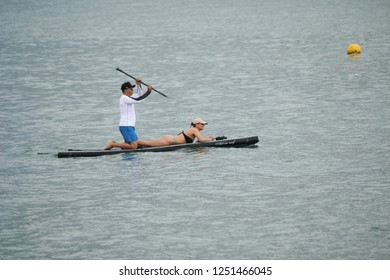 Ilhabela, Sao Paulo, Brazil; September 30 2018: Sup Paddle in Ilhabela. Man con the table and woman enjoying the trip.