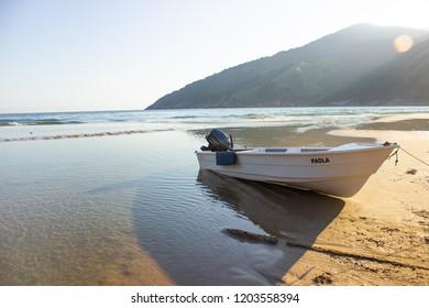 ILHABELA/SAO PAULO/BRAZIL - AUGUST 8, 2018: Boat at the beach - Praia do Bonete.