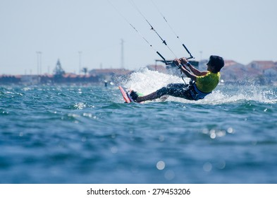 ILHAVO, PORTUGAL - MAY 17, 2015: Paulo Azevedo kitesurfing during the Festival do Vento.