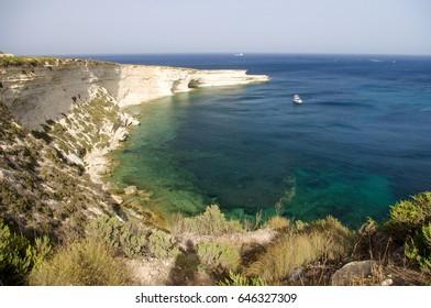 Il-Hofra z-Zghira cove located in Marsaxlokk, Malta