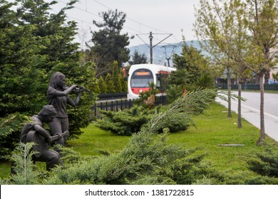 ILKADIM, SAMSUN, TURKEY 24 APRIL 2019: Girl playing violin and boy playing guitar sculpture in Garden of Samsun State Opera and Ballet at Samsun