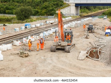 ILKESTON, ENGLAND - AUGUST 1: Construction workers on site next to a section of railway track. In Ilkeston, Derbyshire, England. On 1st August 2016.