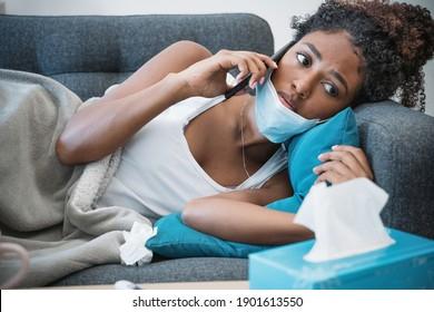Porträt der Illen Afrikanerin mit Grippeinfektion zu Hause Anrufung des Arztes
