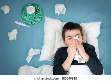 Ill boy lying in bed sad child with images stock photos vectors ill boy lying in bed sad child with fever and ice bag on head thecheapjerseys Choice Image