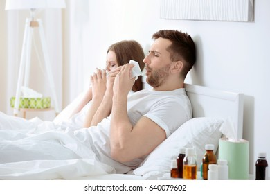 Ill couple in bed
