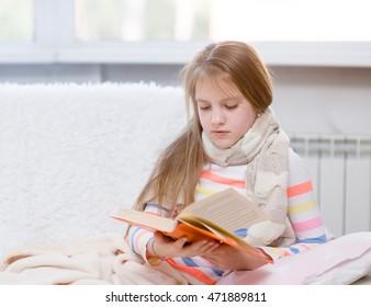 ill girl reading a book