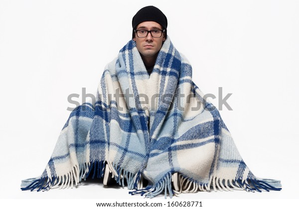 Ill Man covered with plaid blanket isolated against white background