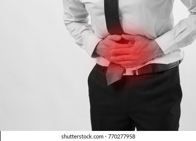 ill man, sick businessman with pain of stomachache; sick business man with stomach ache, belly pain, indigestion, gastritis, diarrhea, nausea, acid reflux, dyspepsia, constipation symptoms