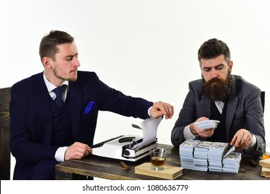 Illegal business concept. Men sitting at table with piles of money and typewriter. Company engaged in illegal business. Businessmen discussing illegal deal while drinking and smoking, white background