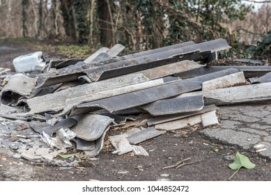 Illegal dumping of hazardous waste such , building materials and other things in nature oder urban. Concept: crime or environmental protection