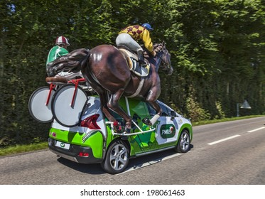 """ILLIERS-COMBRAY,FRANCE,JUL 21:Vehicle of PMU in the publicity caravan driving on a rural road,during the 19th stage- a time trial between Bonneval and Chartres- of """"Le Tour de France"""" on July 21 2012"""