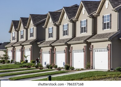 Illinois, United States - circa 2014 - New Residential Attached Row Housing Subdivision Development with garages