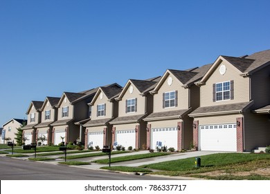 Illinois, United States - circa 2014 - New Residential Attached Row Houses, Subdivision Development, garages, small yards, driveways, real estate, new construction homes, building