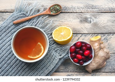 Illness concept. Alternative medicine. Herbal tea on scarf. Lemon, ginger. Top view.