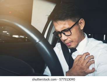 Illness, exhausted, disease, tired for overworked concept. Asian businessman having heart attack while he driving car.