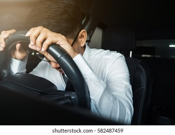 Illness, exhausted, disease, tired for overworked concept. Asian businessman having headache from migraine while he driving car.