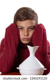 Illness inhaler and medical treatment for caucasian young boy,  asthmatic.