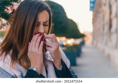 Illness And Sickness. Closeup Of Beautiful Woman Feeling Sick Dripping Nasal Drops In Blocked Nose. Portrait Female Sprays Cold And Sinus Medicine In Runny Nose. Sinusitis treatment. High Resolution